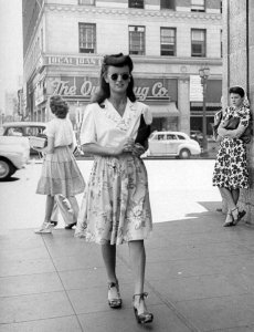 Love 40s Fashion. Young girls of today walking around in barely there shorts, mid drift on show, clearly visible bra, etc. sickens me!