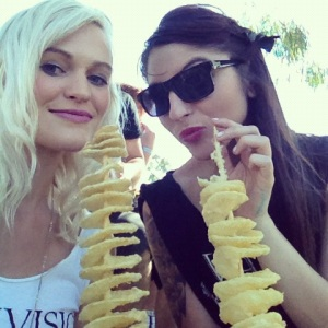 At Soundwave eating potato on a stick with Steph.