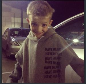 My nephew wearing my YL Have Heart Merch.