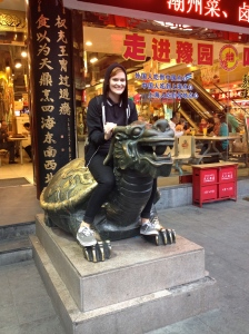 Sitting on mystical creatures in China.